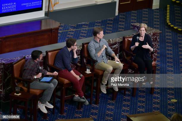 Jon Favreau Jon Lovett and Tommy Vietor hosts of 'Pod Save America' are joined by Senator Elizabeth Warren for a forum on civic engagement at the...