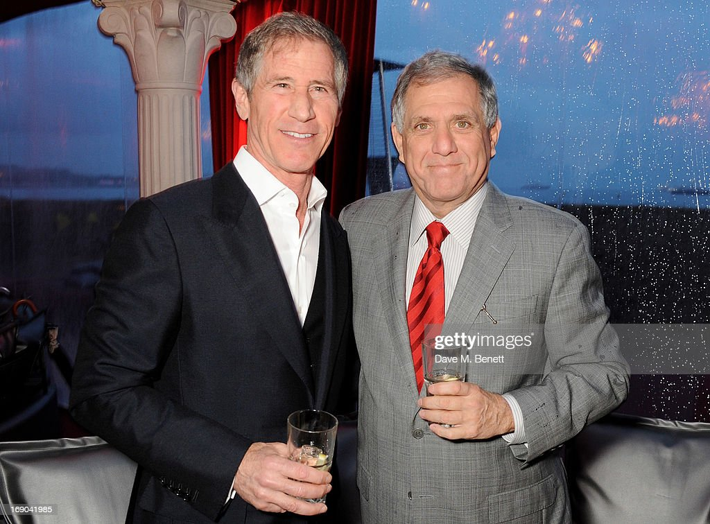 Jon Feltheimer (L) and President and Chief Executive Officer of CBS Corporation Les Moonves attend Lionsgate's The Hunger Games: Catching Fire Cannes Party at Baoli Beach sponsored by COVERGIRL on May 18, 2013 in Cannes, France.