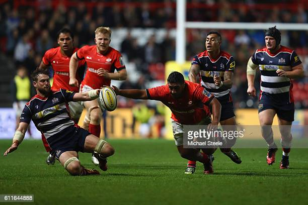 Jon Fisher of Bristol battles for the loose ball alongside Mako Vunipola of Saracens during the Aviva Premiership match between Bristol Rugby and...