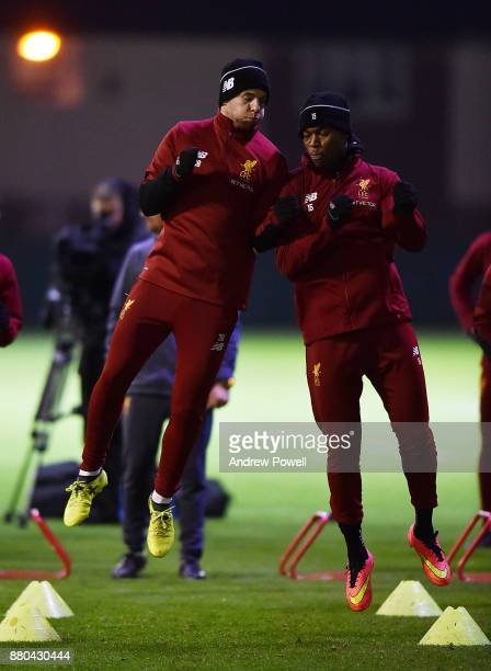 Jon Flanagan and Daniel Sturridge of Liverpool during a training session at Melwood Training Ground on November 27 2017 in Liverpool England