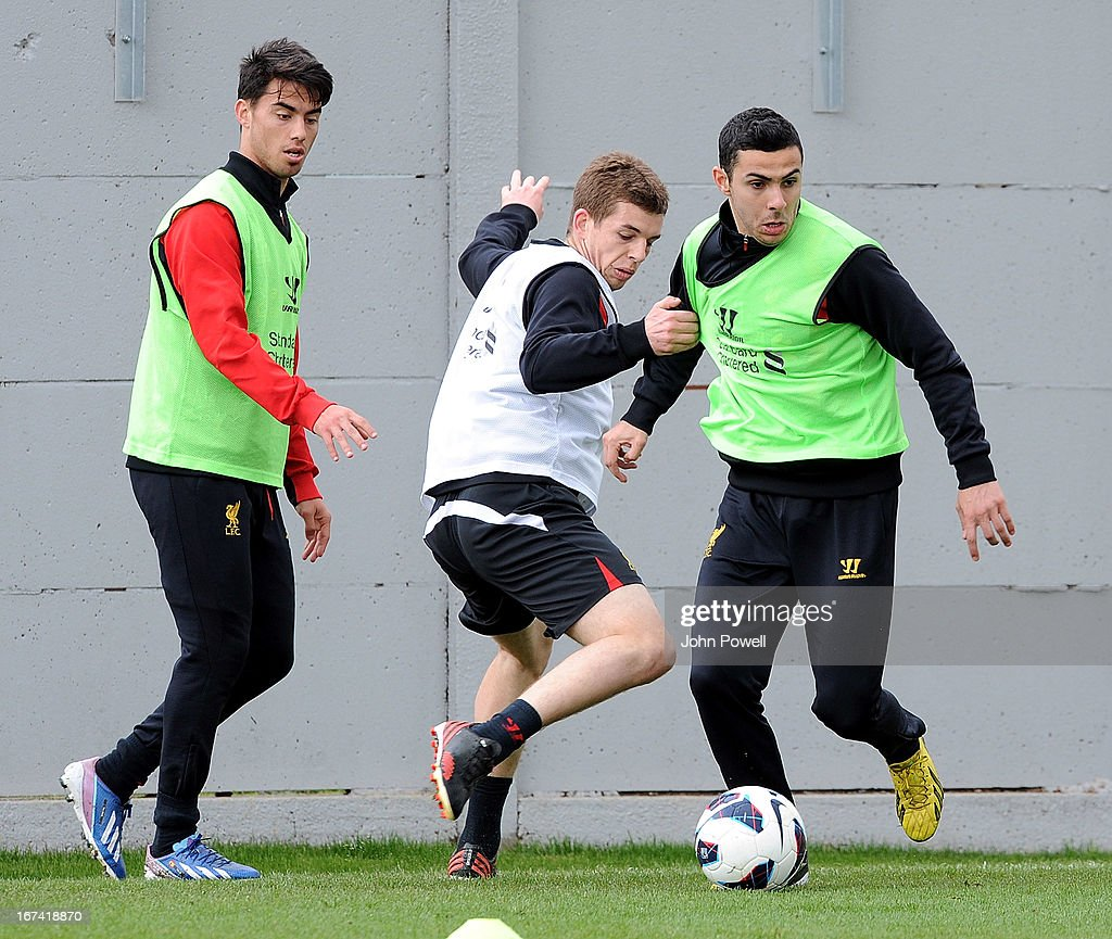 Jon Flanagan and Ousama Assaidi of Liverpool in aciton with Suso during a training session at Melwood Training Ground on April 25, 2013 in Liverpool, England.