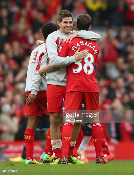 Jon Flanagan is embraced by Steven Gerrard of Liverpool at the end of the Barclays Premier League match between Liverpool and Tottenham Hotspur at...
