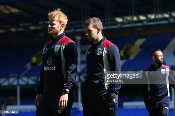 Jon Flanagan of Burnley takes a look around the pitch with a member of the Burnley staff prior to the Premier League match between Everton and...