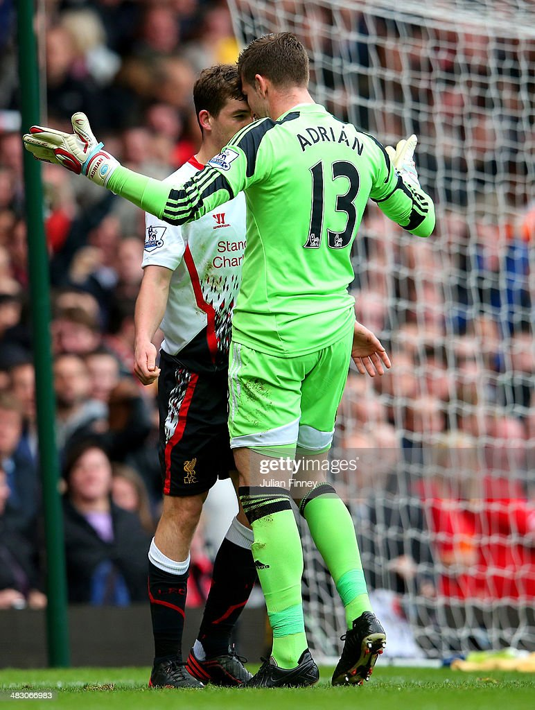 Jon Flanagan of Liverpool and goalkeeper Adrian of West Ham clash after the Liverpool man was brought down by Adrian, conceding a penaltyduring the Barclays Premier League match between West Ham United and Liverpool at Boleyn Ground on April 6, 2014 in London, England.