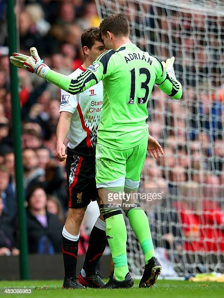 Jon Flanagan of Liverpool and goalkeeper Adrian of West Ham clash after the Liverpool man was brought down by Adrian conceding a penaltyduring the...