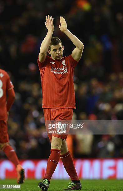 Jon Flanagan of Liverpool claps to the fans at the end of the Barclays Premier League match between Liverpool and Manchester City at Anfield on March...