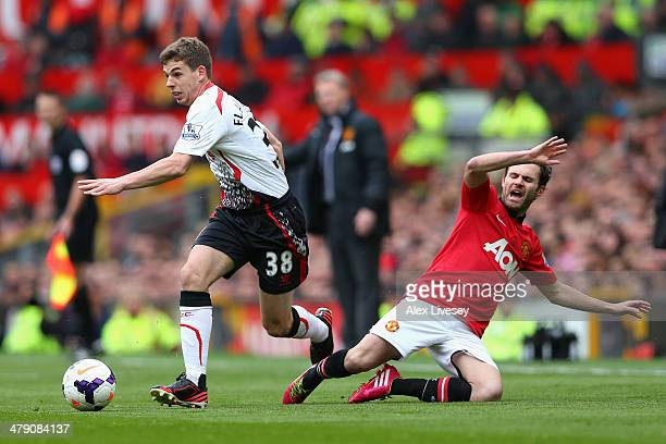Jon Flanagan of Liverpool competes with Juan Mata of Manchester United during the Barclays Premier League match between Manchester United and...
