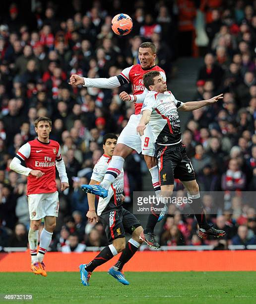 Jon Flanagan of Liverpool goes up with Lucas Podoski of Arsenal during the FA Cup Fifth Round match between Arsenal and Liverpool at Emirates Stadium...