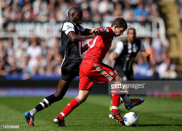 Jon Flanagan of Liverpool is challenged by Demba Ba of Newcastle United during the Barclays Premier League match between Newcastle United and...
