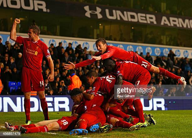 Jon Flanagan of Liverpool is mobbed by his team mates after scoring their third goal during the Barclays Premier League match between Tottenham...