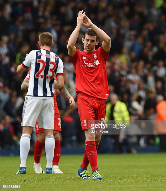 Jon Flanagan of Liverpool shows his appreciation to the fans at the end of the Barclays Premier match between West Bromwich Albion and Liverpool at...