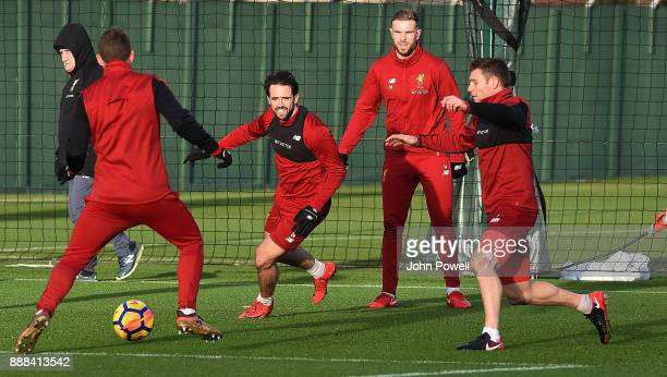 Jon FlanaganDanny IngsJordan Henderson and James Milner of Liverpool during a training session at Melwood Training Ground on December 8 2017 in...