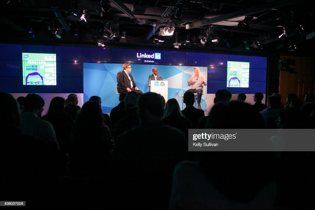 Jon Fortt, Co-Anchor of CNBC's Squawk Alley (center), moderates a debate between LinkedIn Co-Founder and Greylock Partner Reid Hoffman (L) and Founder & CEO of O'Reilly Media Tim O'Reilly (R) on August 23, 2017 at LinkedIn in San Francisco, California.
