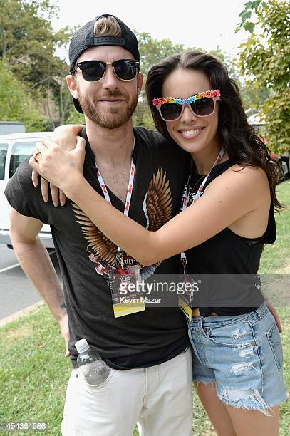 Jon Foster and Chelsea Tyler of Kaneholler pose backstage at the 2014 Budweiser Made In America Festival at Benjamin Franklin Parkway on August 30...