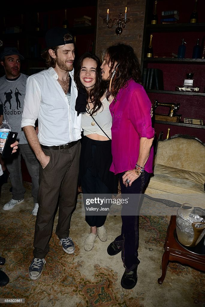 Jon Foster, Chelsea Tyler of BadBad and her father Steven Tyler pose for picture after performing on December 7, 2013 in Fort Lauderdale, Florida.