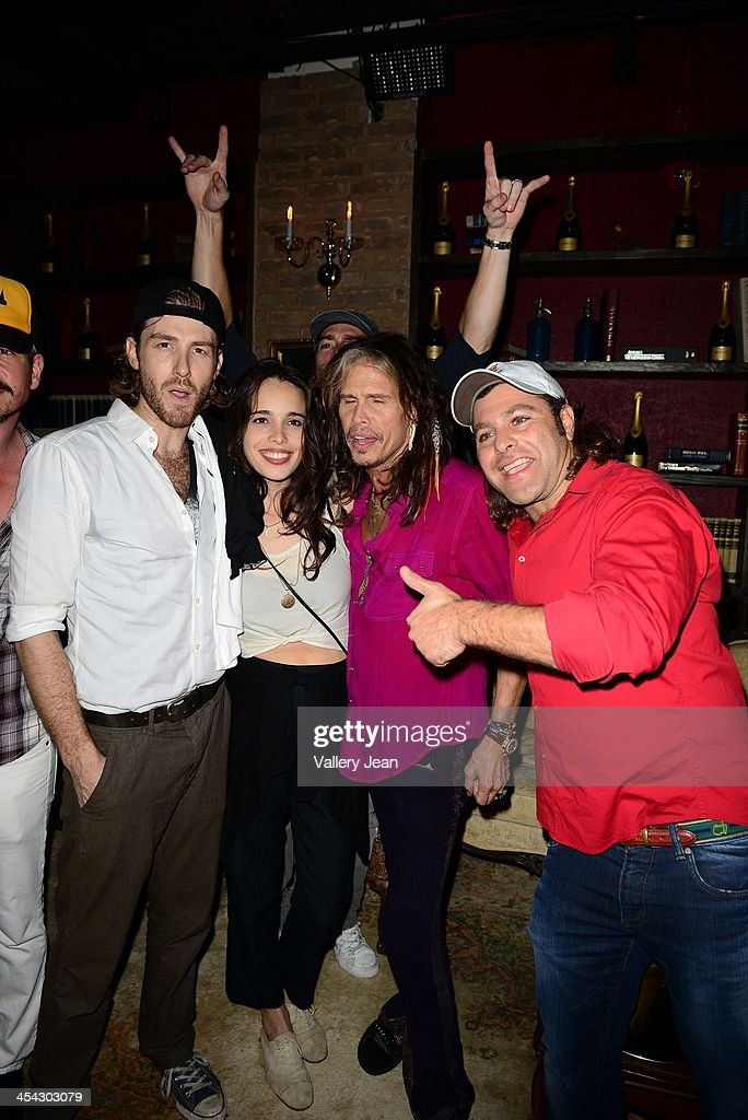 Jon Foster, Chelsea Tyler of BadBad, her father Steven Tyler and Jeff John pose for picture after performing on December 7, 2013 in Fort Lauderdale, Florida.