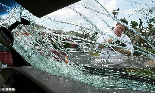 Jon Frederickson an Allstate catastrophic claims adjuster assesses the damage to a vehicle owned by Gil Iles of Punta Gorda Florida on Tuesday August...