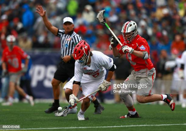 Jon Garino of the Maryland Terrapins picks up the ball against Jake Withers of the Ohio State Buckeyes during the NCAA Division I Men's Lacrosse...