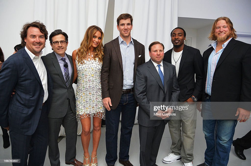 Jon Geiselman, Paul Guyardo, Hannah Davis, Eli Manning, Keith Kazerman, Hakeem Nicks and Nick Mangold attend DIRECTV's 2013 National Ad Sales Upfront on May 7, 2013 in New York City.