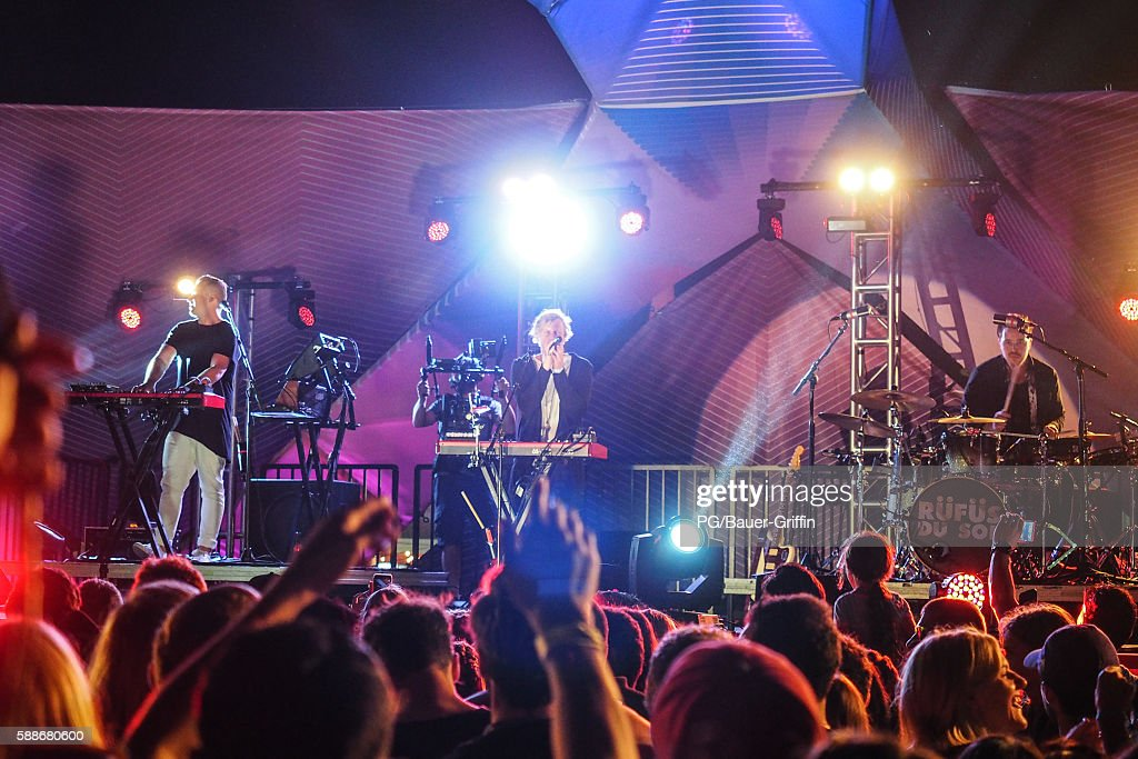 Jon George, Tyrone Lindqvist and James Hunt of Rufus du Sol perform on the Santa Monica Pier on August 11, 2016 in Los Angeles, California.