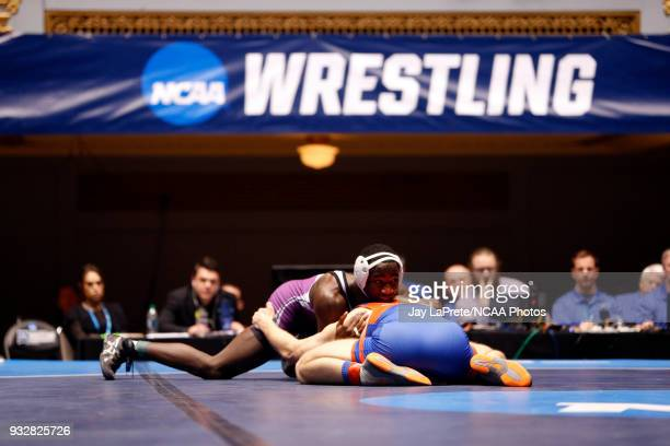 Jon Goetz of WisconsinPlatteville wrestles Jairod James of Mount Union in the 174 weight class during the Division III Men's Wrestling Championship...