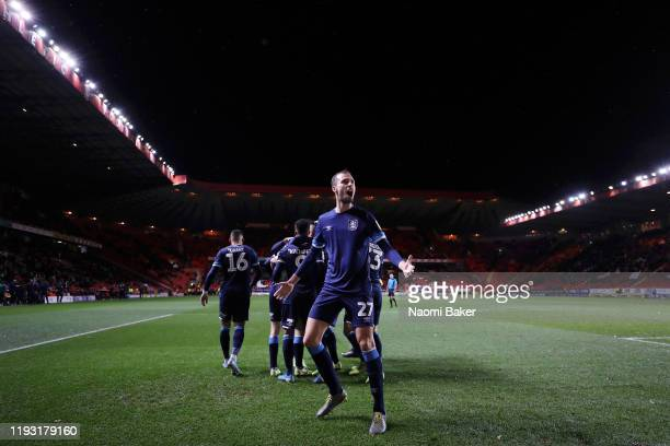 Jon Gorenc Stankovic of Huddersfield Town celebrates after Matty Daly of Huddersfield Town scores his sides first goal during the Sky Bet...