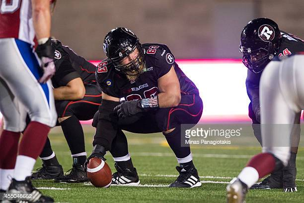 Jon Gott of the Ottawa Redblacks calls out instructions to teammates during the CFL game against the Montreal Alouettes at Percival Molson Stadium on...