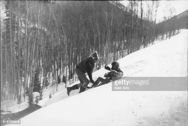 Jon Gould helping Andy Warhol get up after a snowmobile crash documented in 'The Andy Warhol Diaries' on new year's day January 1 1983 in Aspen...
