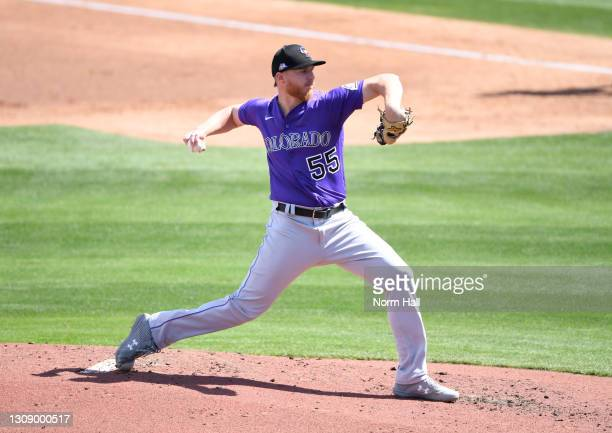 Jon Gray of the Colorado Rockies delivers a pitch against the Milwaukee Brewers during a spring training game at American Family Fields of Phoenix on...
