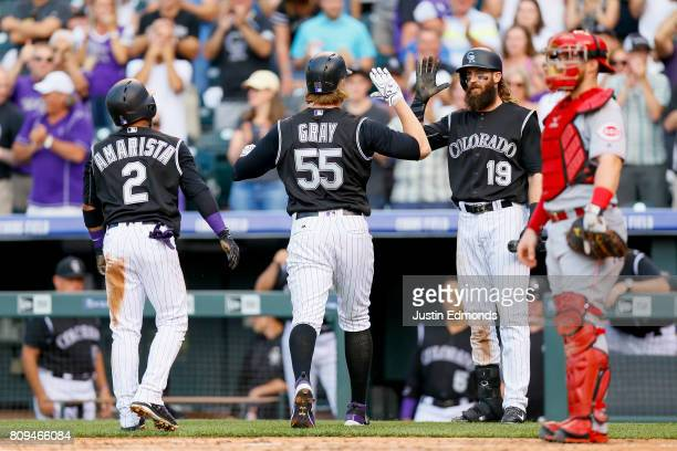 Jon Gray of the Colorado Rockies is congratulated by Alexi Amarista and Charlie Blackmon after hitting a 467foot tworun home run during the second...
