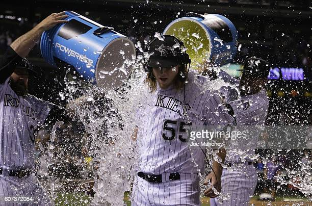 Jon Gray of the Colorado Rockies is doused by teammates after pitching a complete game shutout against the San Diego Padres at Coors Field on...