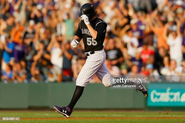 Jon Gray of the Colorado Rockies tips his cap while trotting around the bases after hitting a 467foot home run during the second inning against the...