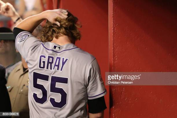 Jon Gray of the Colorado Rockies walks on the bench after being pulled from the game in the second inning of the National League Wild Card game...