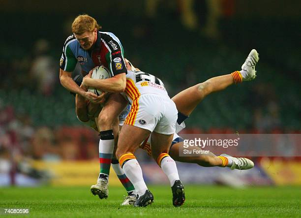 Jon Grayson of Harlequins charges through the Catalans tacklers during the Engage Super League match between Catalans Dragons and Harlequins RL at...