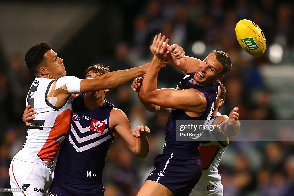 Jon Griffin of the Dockers handballs during the round seven AFL match between the Fremantle Dockers and the Greater Western Sydney Giants at Domain Stadium on May 7, 2016 in Perth, Australia.