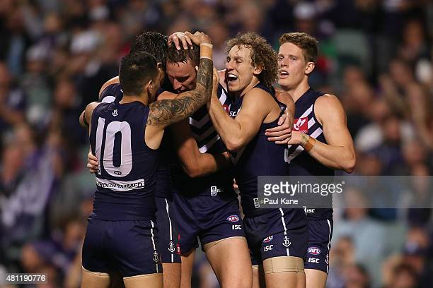 Jon Griffin of the Dockers is congratulated after kicking a goal during the round 16 AFL match between the Fremantle Dockers and the Carlton Blues at...