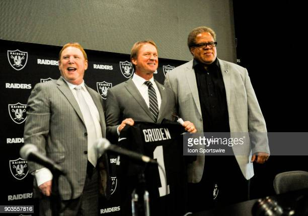 Jon Gruden and Mark Davis react to a comment from the crowd after the Jon Gruden Press Conference on January 9 2017 at Raiders Headquarters in...