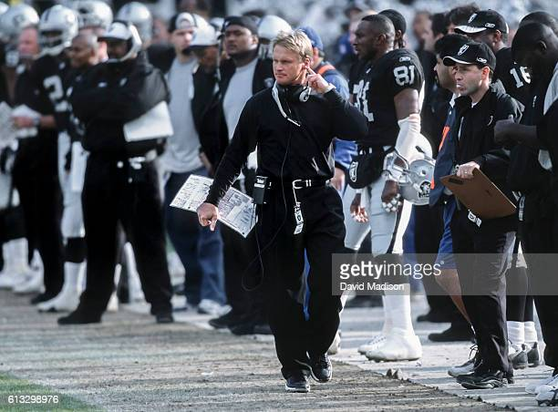 Jon Gruden Head Coach of the Oakland Raiders watches from the sidelines during a National Football League game against the New York Jets played on...