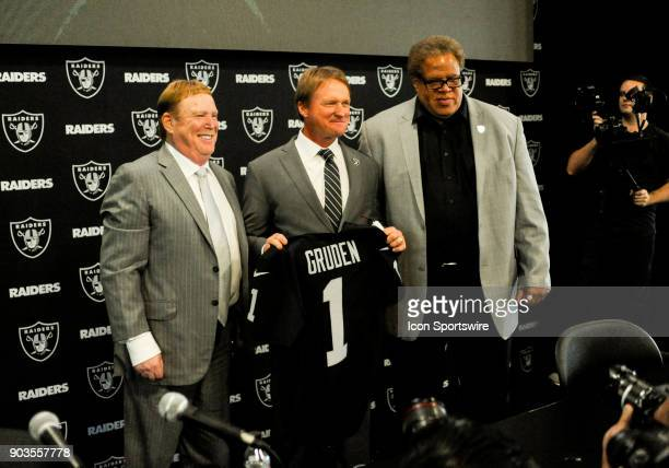 Jon Gruden holds up a Raiders jersey to media members after the Jon Gruden Press Conference on January 9 2017 at Raiders Headquarters in Alameda CA