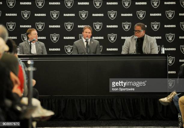Jon Gruden sits in between Reggie McKenzie and Mark Davis during the Jon Gruden Press Conference on January 9 2017 at Raiders Headquarters in Alameda...