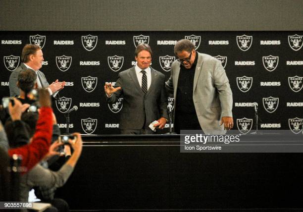 Jon Gruden waves to the crowd as he is introduced as the next Head Coach of the Oakland Raiders during the Jon Gruden Press Conference on January 9...