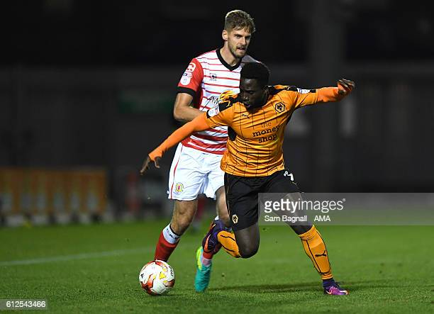 Jon Gutherie of Crewe Alexandra and Nouha Dicko of Wolverhampton Wanderers during the EFL Checkatrade Trophy match between Crewe Alexandra and...