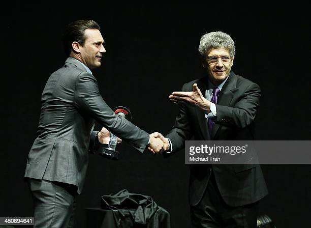 Jon Hamm accepts an awards from Chairman of the Walt Disney Studios Alan F Horn onstage at the Walt Disney Studios presentation at Cinemacon 2014 Day...