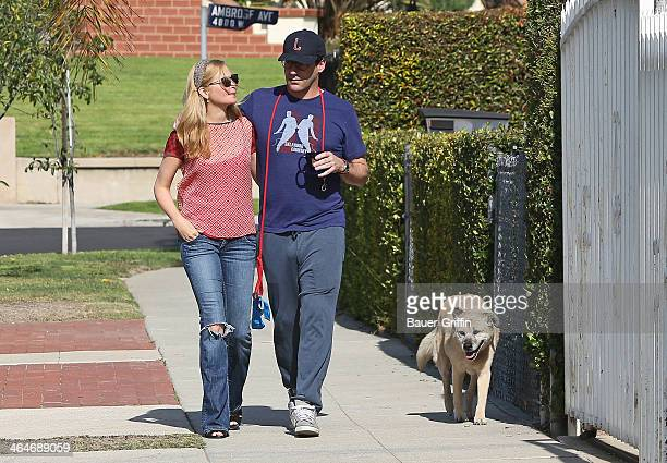 Jon Hamm and Jennifer Westfeldt are seen as they take their dog for a walk on January 23 2014 in Los Angeles California