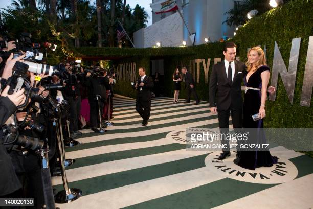 Jon Hamm and Jennifer Westfeldt arrive at the Vanity Fair Oscar Party for the 84th Annual Academy Awards at the Sunset Tower on February 26 2012 in...