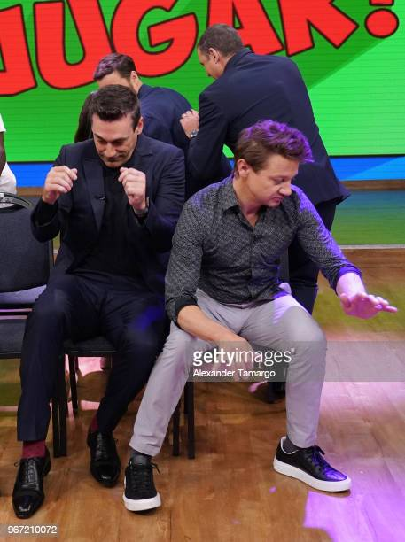 Jon Hamm and Jeremy Renner are seen playing musical chairs on the set of 'Despierta America' at Univision Studios to promote the film 'TAG' on June 4...