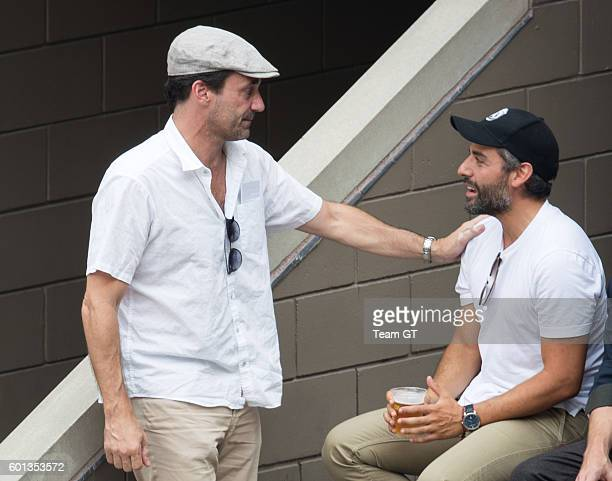 Jon Hamm and Oscar Isaac are seen at USTA Billie Jean King National Tennis Center on September 9 2016 in the Queens borough of New York City