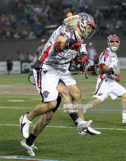Jon Hayes of the Boston Cannons is defended by Steve Giannone of the Denver Outlaws at Harvard Stadium on May 21 2011 in Boston Massachusetts