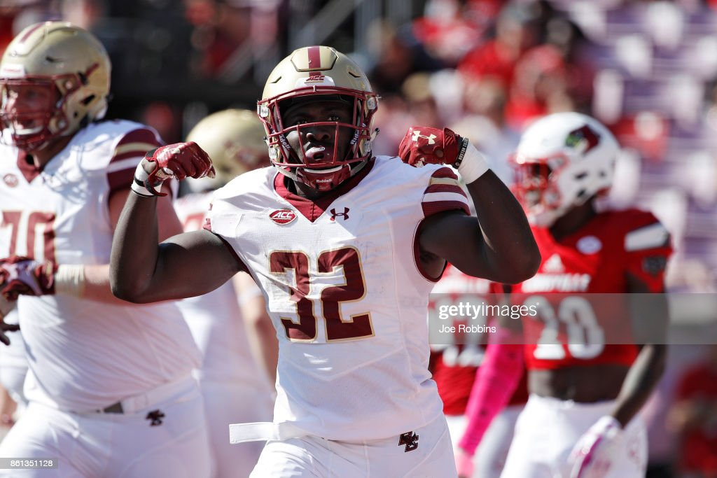 Jon Hilliman #32 of the Boston College Eagles celebrates after rushing for a six-yard touchdown in the third quarter of a game against the Louisville Cardinals at Papa John's Cardinal Stadium on October 14, 2017 in Louisville, Kentucky. Boston College won 45-42.