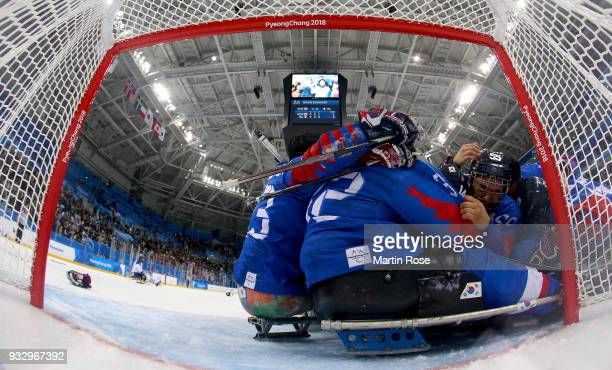 Jon Ho Jang of Korea celebrate with his team mates after winning the bronze medal over Italy in the Ice Hockey bronze medal game between Korea and...